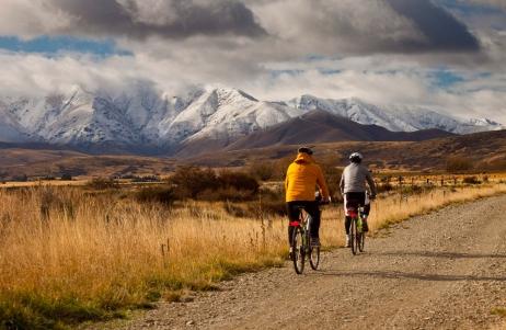 Cyclists on Otago Rail Trail near Oturehua, Central Otago, New Zealand.