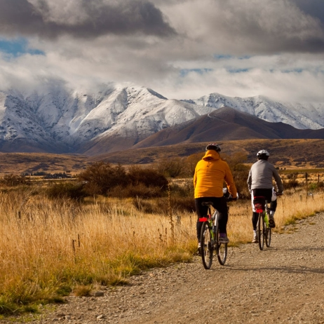 Cyclists on Otago Rail Trail near Oturehua, Central Otago, New Zealand.